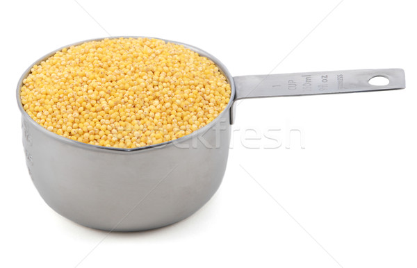 Millet grains in a measuring cup Stock photo © sarahdoow