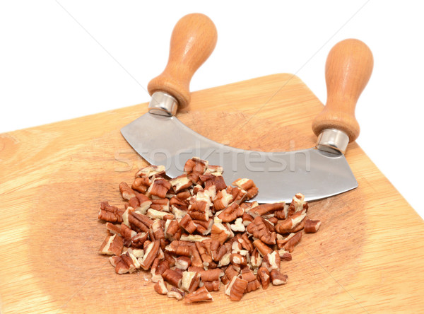 Chopped pecan nuts with a rocking knife Stock photo © sarahdoow