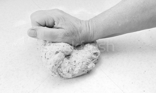 Woman kneading bread dough by hand Stock photo © sarahdoow