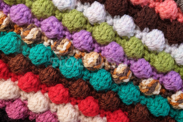 Multi-coloured crochet bobble stitches diagonal stripes backgrou Stock photo © sarahdoow