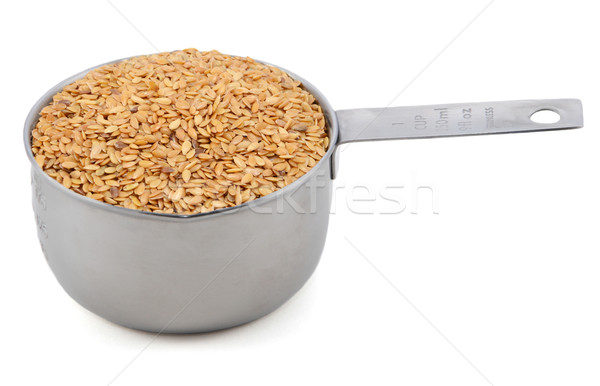 Golden linseed in an American cup measure Stock photo © sarahdoow