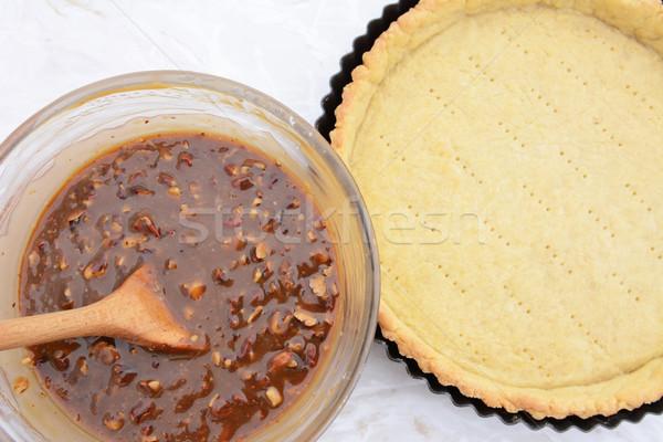 Making pecan pie - nutty pie filling and pie crust Stock photo © sarahdoow