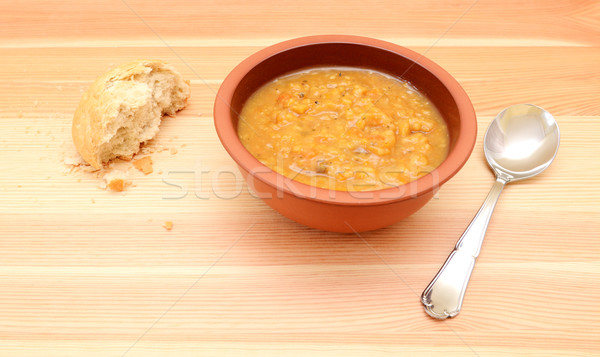 Half-eaten bread roll with a bowl of vegetable soup Stock photo © sarahdoow