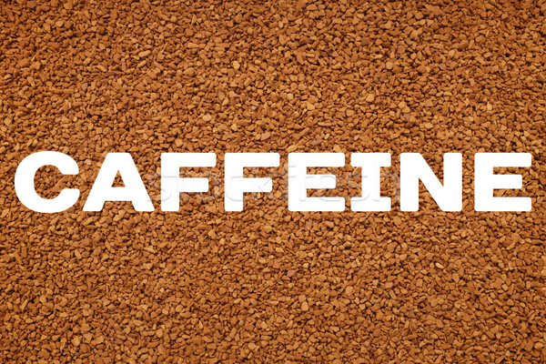 CAFFEINE text over background of instant coffee granules Stock photo © sarahdoow