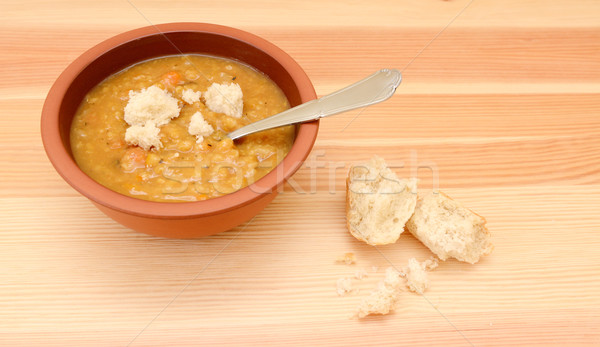 Thick lentil soup with pieces of bread Stock photo © sarahdoow