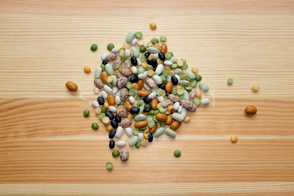 Mixed dried beans and peas on a wooden background Stock photo © sarahdoow