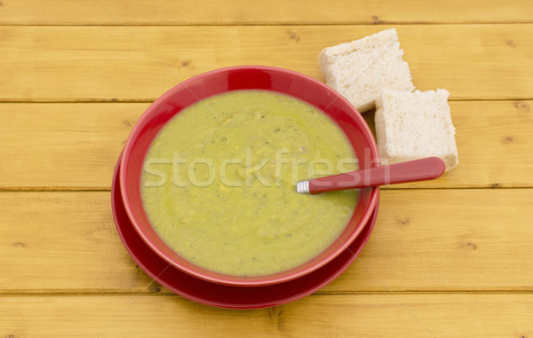 Chunks of bread with bowl of green soup Stock photo © sarahdoow
