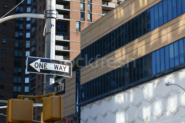 ONE WAY road sign points left on New York street Stock photo © sarahdoow
