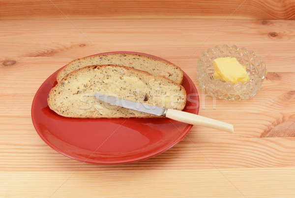 Buttered slices of bread on a red plate  Stock photo © sarahdoow