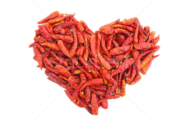 Spicy red birds eye chilli peppers in a heart shape Stock photo © sarahdoow