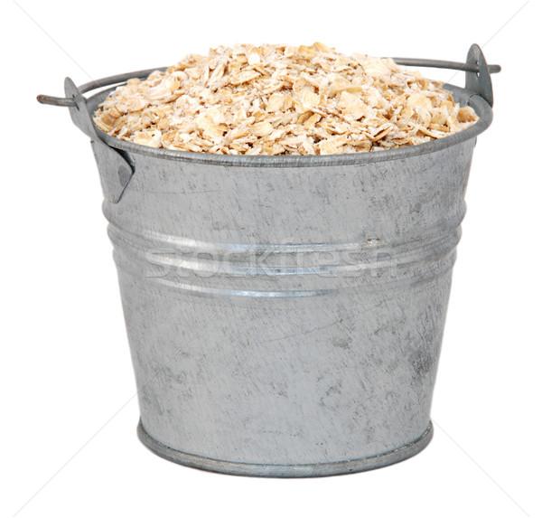 Porridge oats in a miniature metal bucket Stock photo © sarahdoow