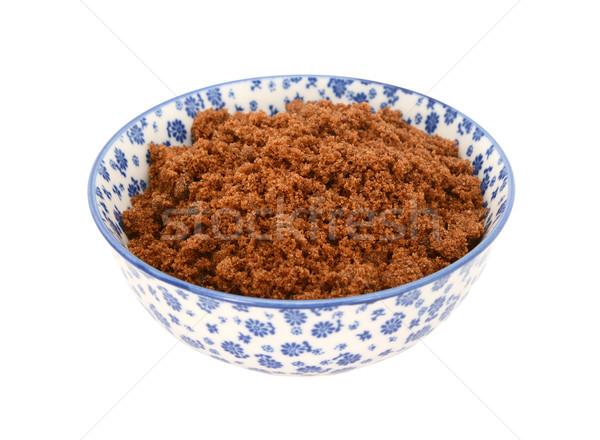 Dark brown soft sugar in a blue and white china bowl Stock photo © sarahdoow