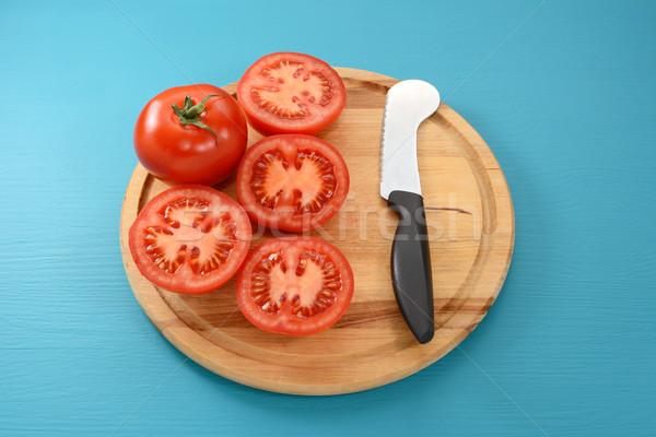 Whole tomato and halves with tomato knife  Stock photo © sarahdoow