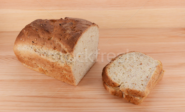 Cut loaf of freshly baked bread with a PB&J sandwich Stock photo © sarahdoow