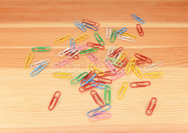 Multi-coloured paper clips scattered Stock photo © sarahdoow