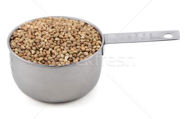 Hemp seeds in a measuring cup Stock photo © sarahdoow