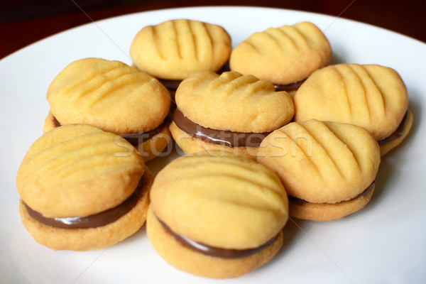 Plate of shortbread biscuits with chocolate filling Stock photo © sarahdoow