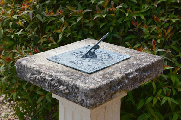 солнечные часы каменные медь Японский кустарник саду Сток-фото © sarahdoow