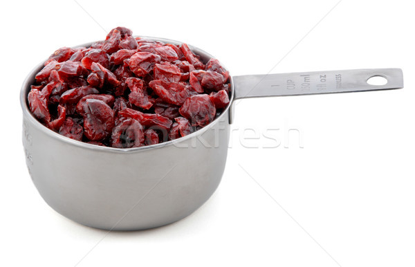 Dried cranberries presented in an American metal cup measure Stock photo © sarahdoow