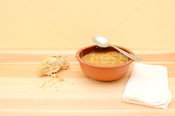Spoon resting on a bowl of vegetable soup Stock photo © sarahdoow