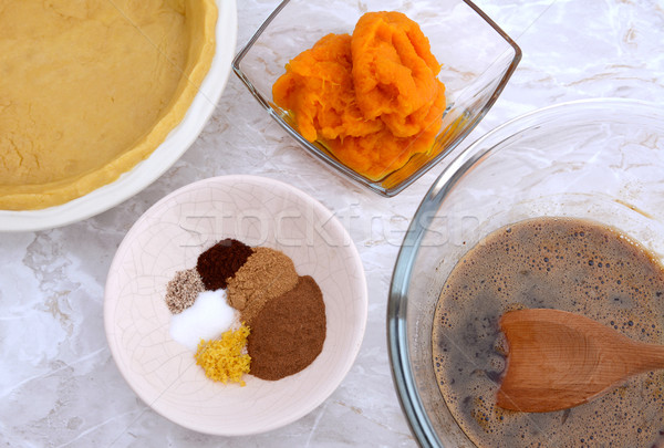Making pumpkin pie - pastry crust, pumpkin, spices and filling Stock photo © sarahdoow