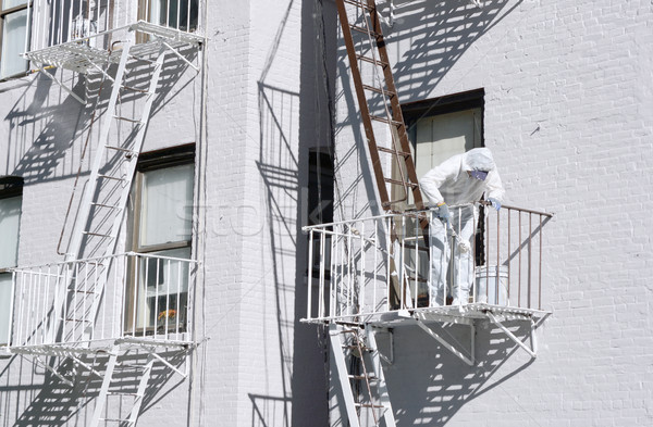 Building painter painting metal fire escapes white Stock photo © sarahdoow