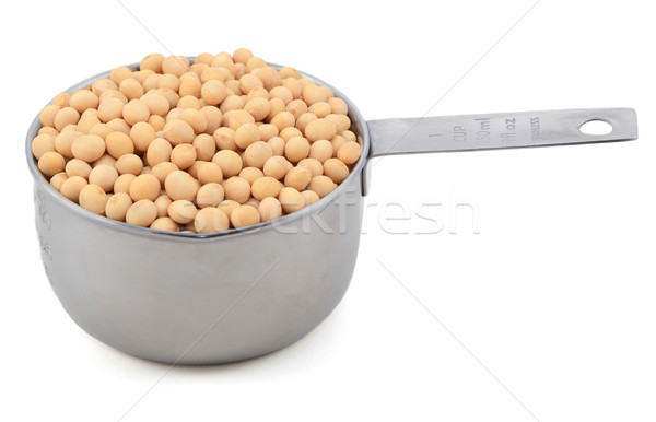 Soybeans, or soya beans, in a measuring cup Stock photo © sarahdoow