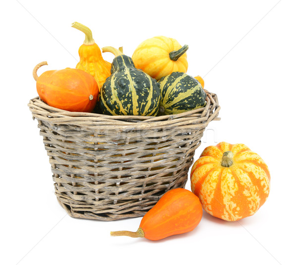 Green, orange and yellow ornamental gourds in a basket Stock photo © sarahdoow