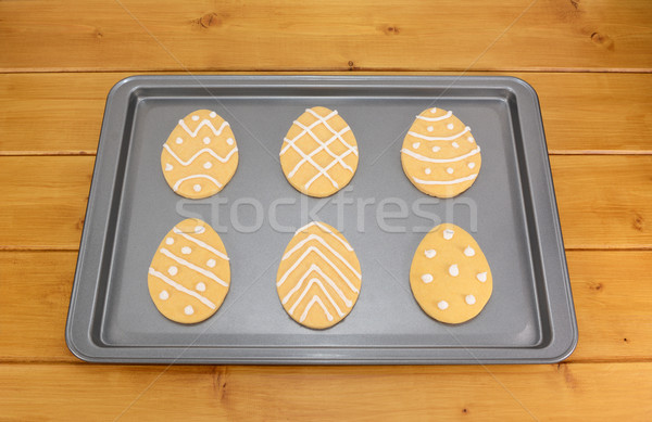 Frosted Easter egg cookies on a baking tray Stock photo © sarahdoow