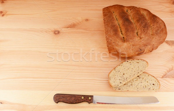 Stock photo: Fresh loaf of bread, cut slices and bread knife