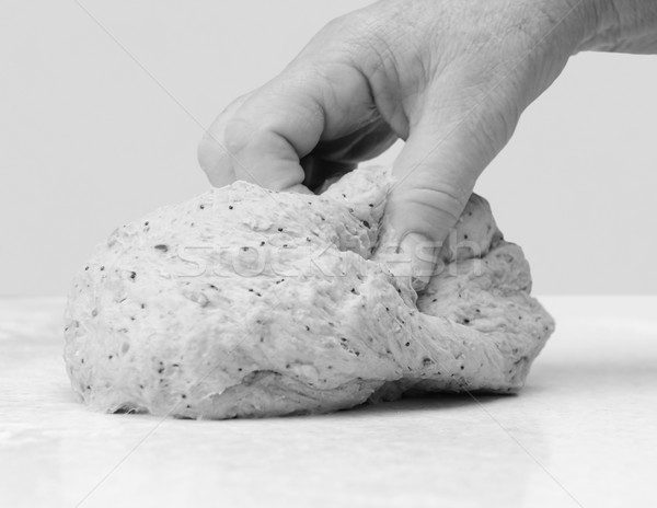 Woman's hand kneading bread dough Stock photo © sarahdoow