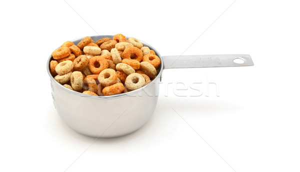 Multigrain hoops breakfast cereal in a measuring cup Stock photo © sarahdoow