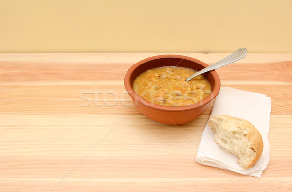 Serving of chunky vegetable soup and half a bread roll Stock photo © sarahdoow
