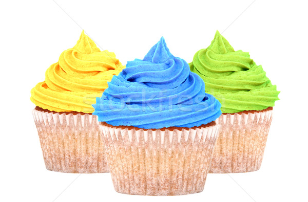 Three cupcakes with yellow, blue and green icing Stock photo © sarahdoow