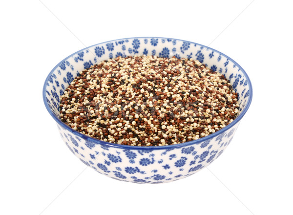 Mixed red, white and black quinoa in a blue and white china bowl Stock photo © sarahdoow
