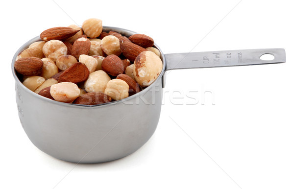 Mixed nuts presented in an American metal cup measure Stock photo © sarahdoow