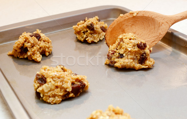 Stock photo: Cookie dough being spooned onto baking sheet