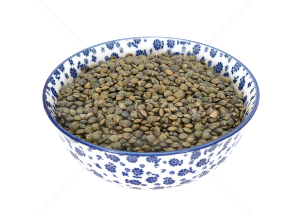 Marbled dark green lentils in a blue and white china bowl Stock photo © sarahdoow