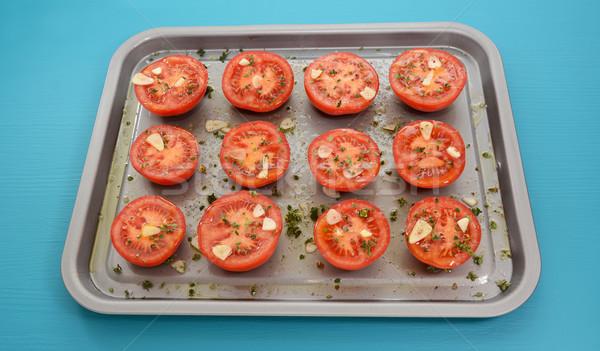 Tomatoes on a baking tray ready for roasting Stock photo © sarahdoow