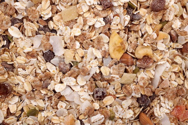 Background of muesli - cereal with seeds, fruit and nuts Stock photo © sarahdoow
