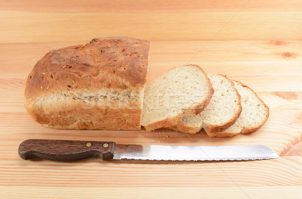 Three slices cut from a loaf of bread with a knife Stock photo © sarahdoow