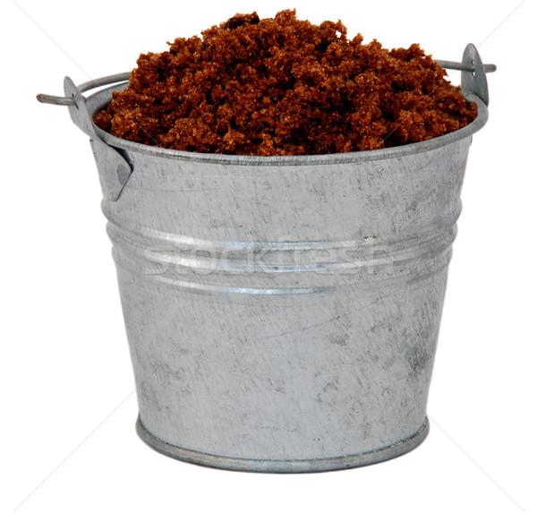 Dark brown soft / muscovado sugar in a miniature metal bucket Stock photo © sarahdoow