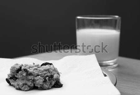 Half-eaten cookie with a half drunk glass of milk Stock photo © sarahdoow