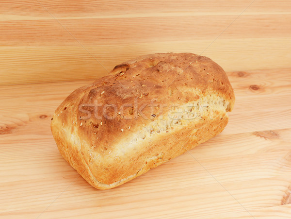 Freshly baked loaf of oat and linseed bread Stock photo © sarahdoow