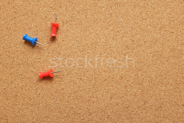 Three push pins on a cork noticeboard Stock photo © sarahdoow