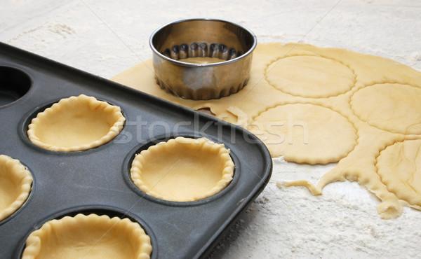 Pastry circles cut and lining a metal bun tin Stock photo © sarahdoow