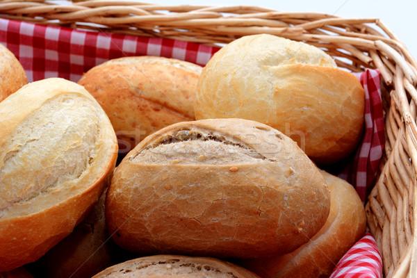 Stock photo: Tasty fresh bread rolls in a basket