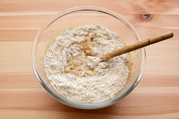 Flour being stirred into batter for banana bread Stock photo © sarahdoow