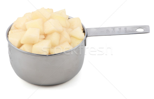 Diced pear flesh in a cup measure Stock photo © sarahdoow