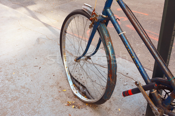 Loose tyre on abandoned, rusty bicycle Stock photo © sarahdoow
